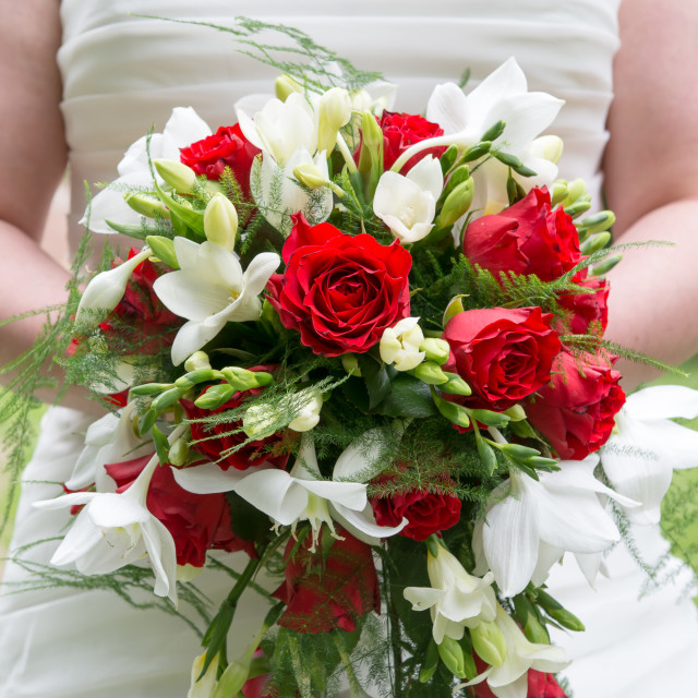 """Bride holding wedding bouquet"" stock image"