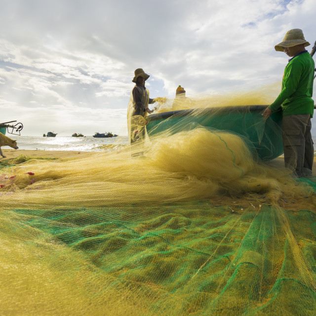"""fisherman working at the beach"" stock image"