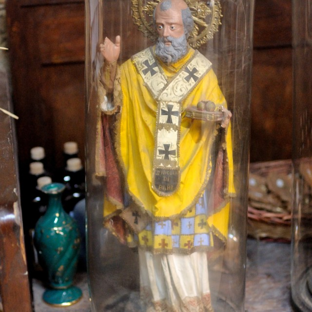 """An ancient statue of St. Joseph in the bell jar"" stock image"
