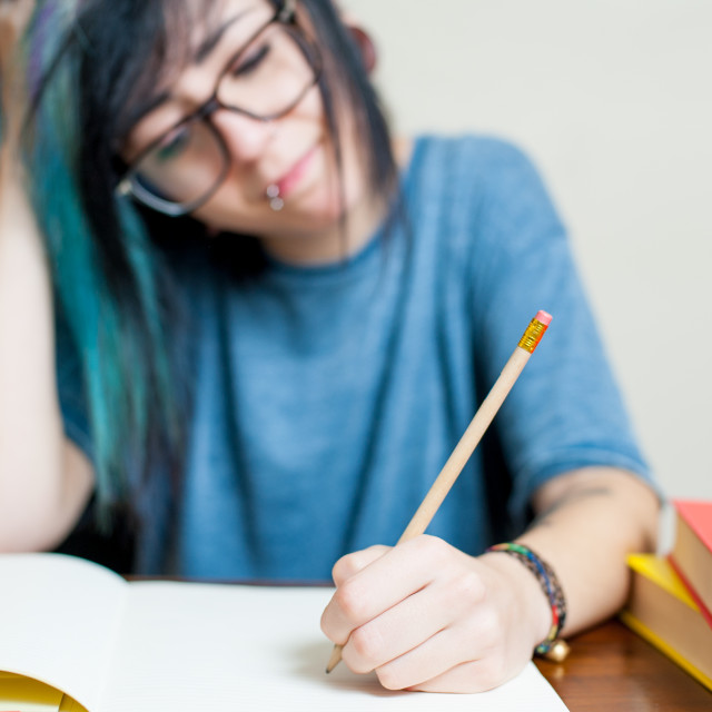 """Young tired female student"" stock image"