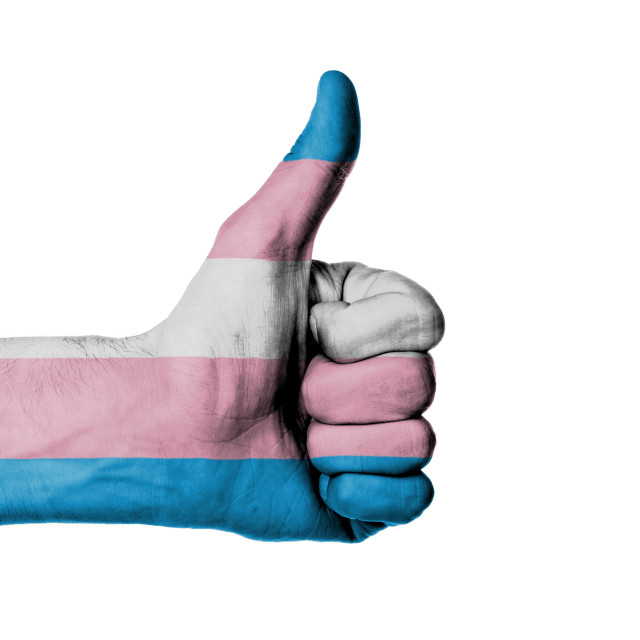 """Closeup of male hand showing thumbs up sign"" stock image"