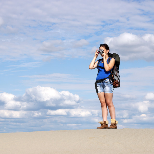 """beautiful girl with camera hiking in desert"" stock image"
