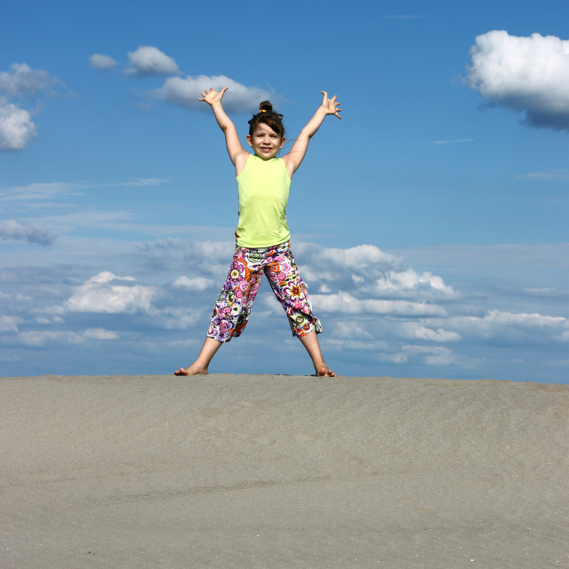 """happy girl with raised hands on the beach"" stock image"