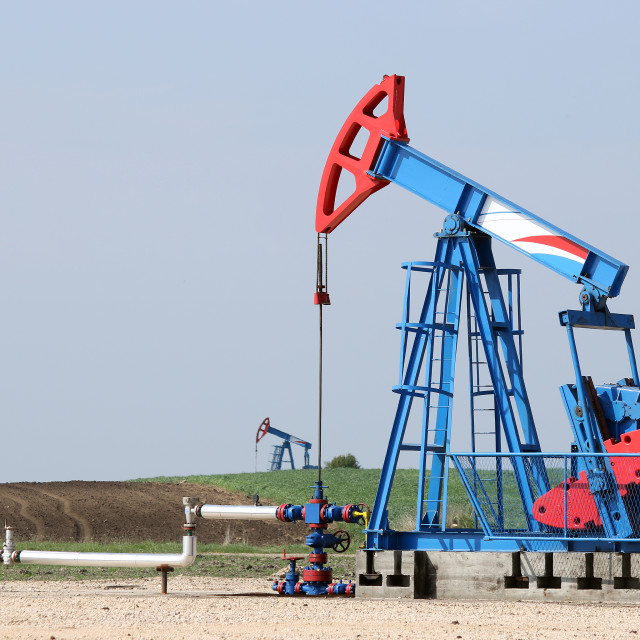 """two oil pump jack on oilfield"" stock image"