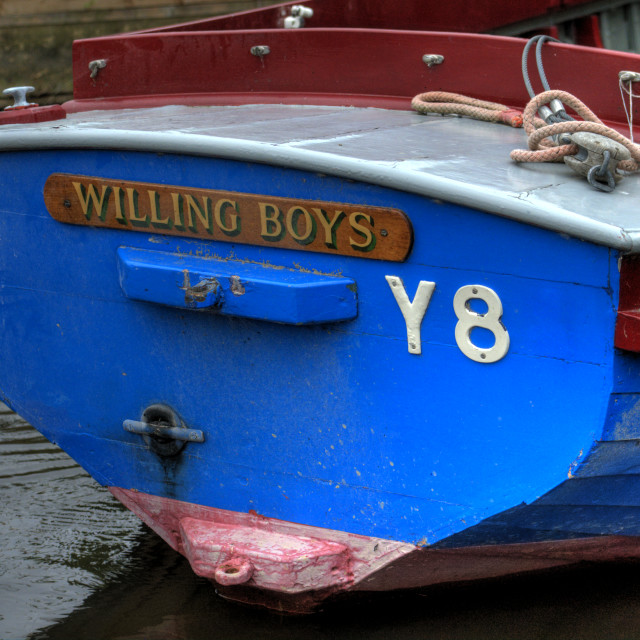 """'Willing Boys' Name on Plaque of Small Boat"" stock image"