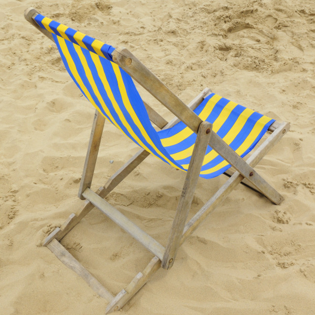 """Empty Beach Deckchair"" stock image"