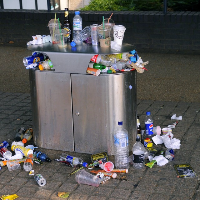 """Overflowing Rubbish Bin"" stock image"