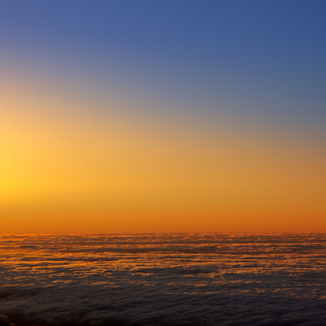 """Sunset sky over haze sea of clouds in La Palma"" stock image"