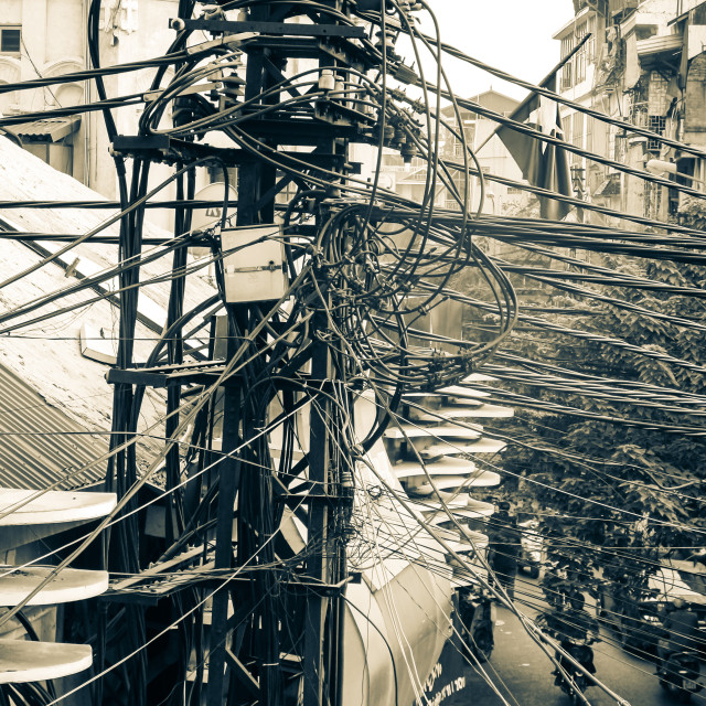 """""""Electrical and Telephone Lines at an Intersection in Hanoi"""" stock image"""