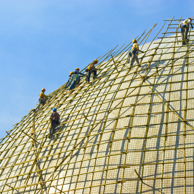 """""""Closeup of construction worker assembling scaffold on building site"""" stock image"""