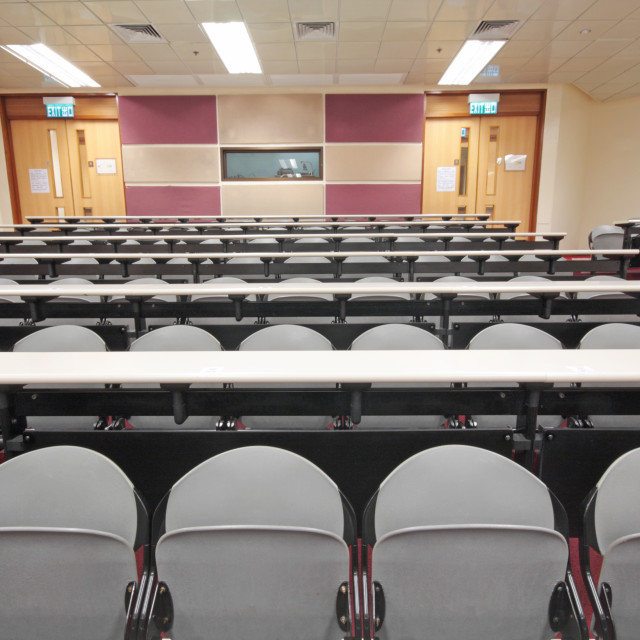 """""""Empty hall for presentation with grey armchairs"""" stock image"""