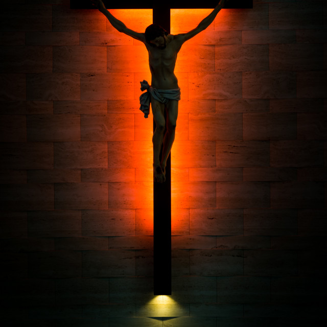 """Catholic Christian Crucifix in silhouette, with tabernacle under"" stock image"
