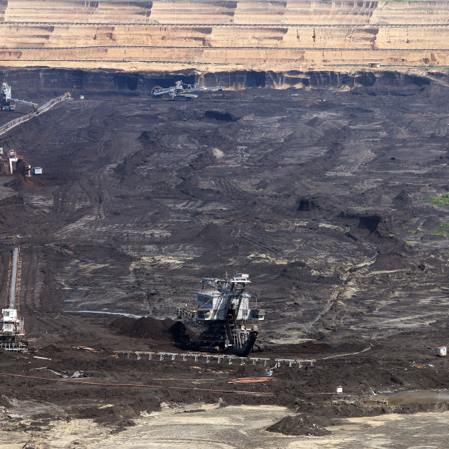 """""""excavator digging and mining on open coal mine"""" stock image"""