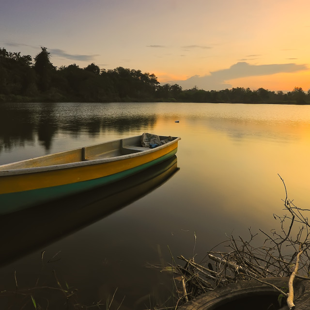 """Sunset landscape with stranded boats"" stock image"