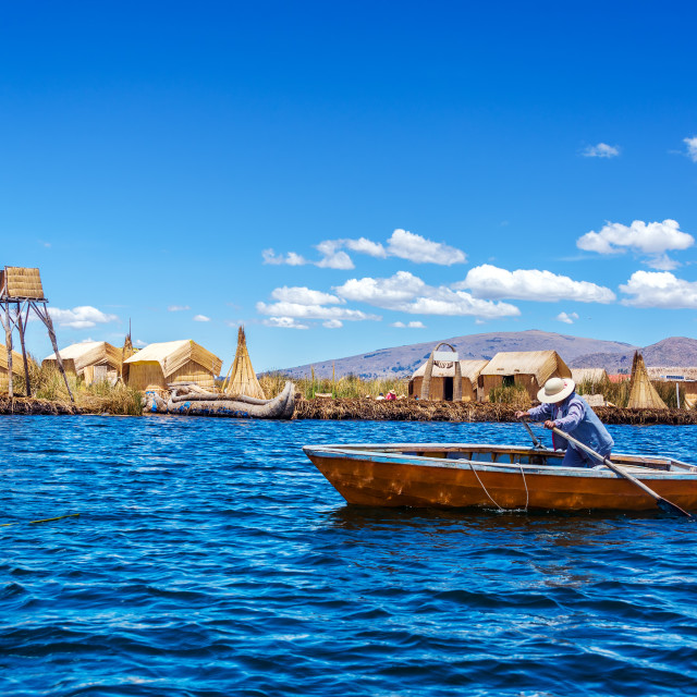 """Rowboat on Lake Titicaca"" stock image"