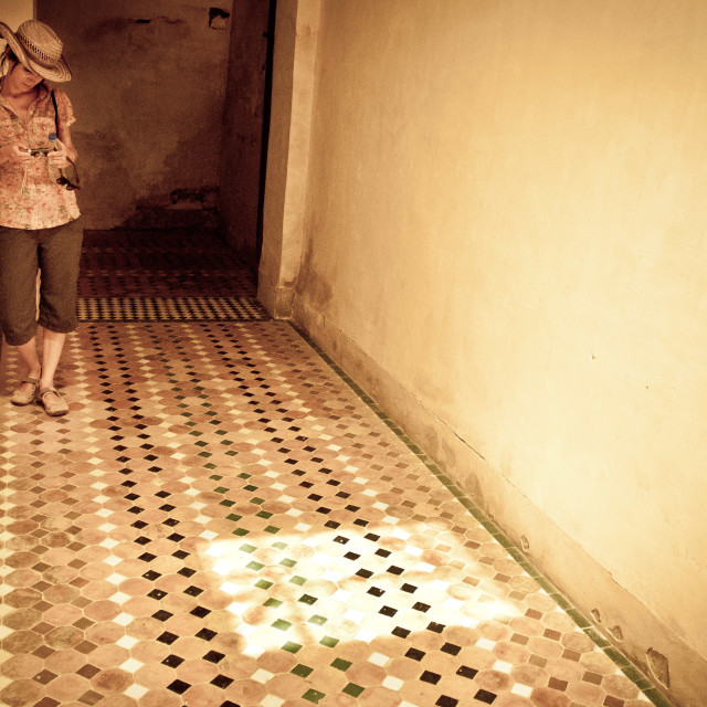 """Woman in a Moroccan tiled hallway."" stock image"