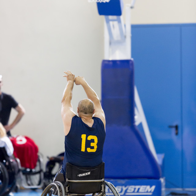 """""""Basketball in wheelchairs for physically disabled players scoring"""" stock image"""