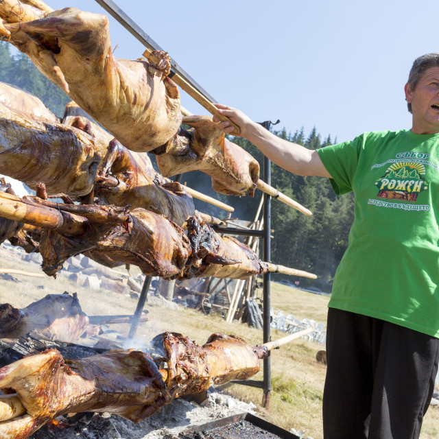 """""""Lambs on spits roasting cook"""" stock image"""