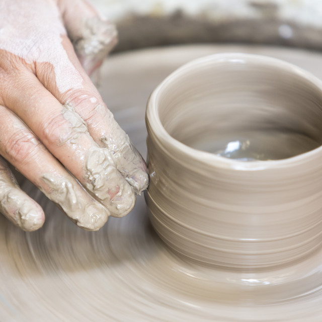 """Making a pottery cup on the wheel"" stock image"