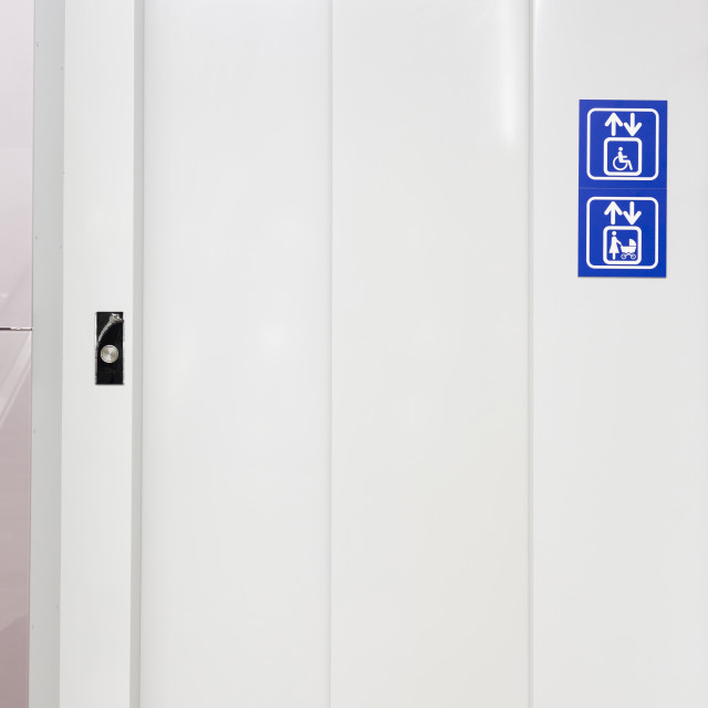 """""""Elevator for mothers and physically disabled"""" stock image"""