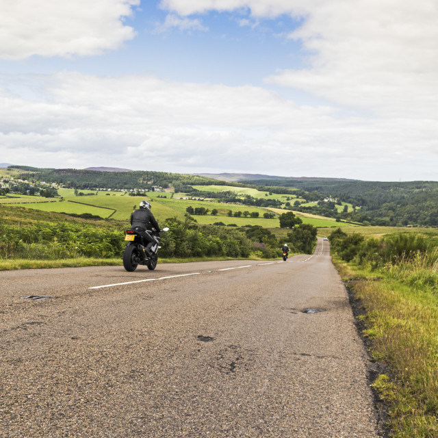 """""""Country road with motorcyclists"""" stock image"""