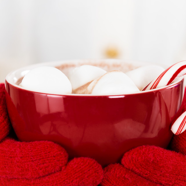 """Hot Chocolate with marshmallows and a candy cane in a red cup"" stock image"