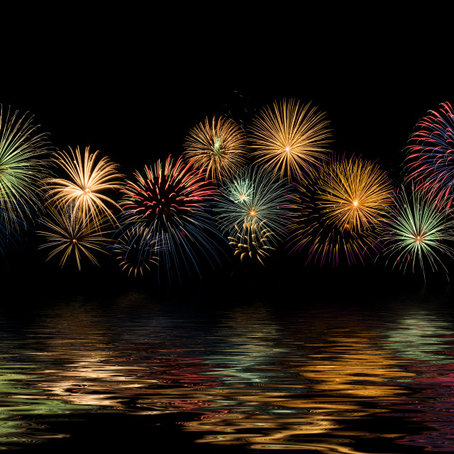 """""""Festive fireworks display with reflections"""" stock image"""