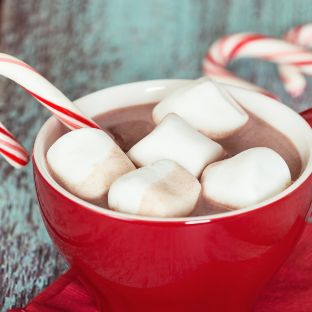 """Hot Chocolate with marshmallows and candy cane in a red cup"" stock image"