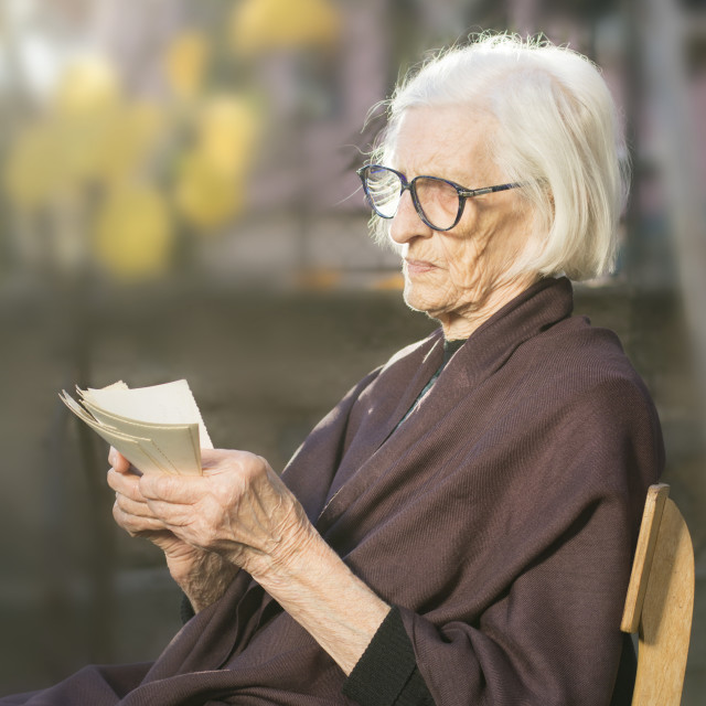 """""""Grandma looking at some very old photos"""" stock image"""