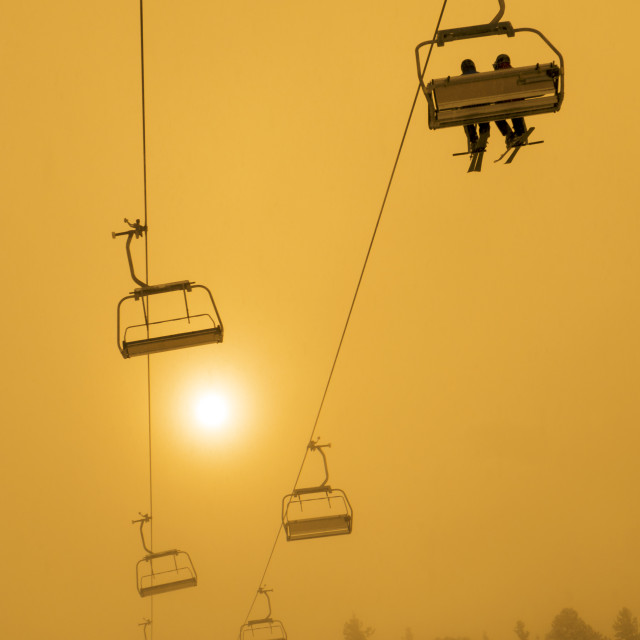 """Ski Chair Lift Sunset or Sunrise"" stock image"