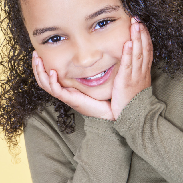 """""""Happy Cheeky African American Mixed Race Girl Child"""" stock image"""