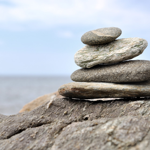"""piled stones on rock"" stock image"