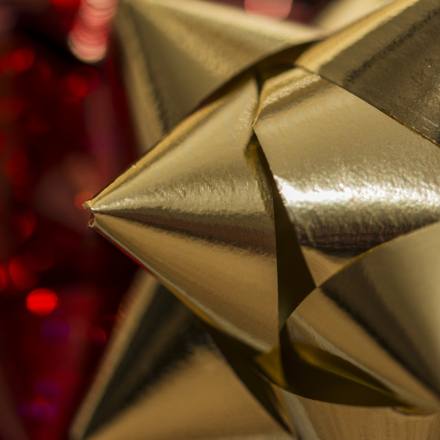 """Close up of a gold christmas gift bow"" stock image"