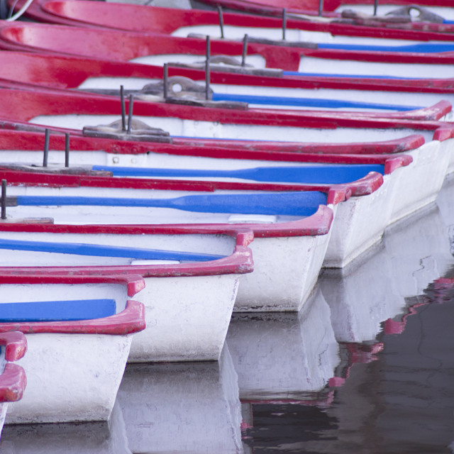"""""""Small boats at the pier of a lake"""" stock image"""