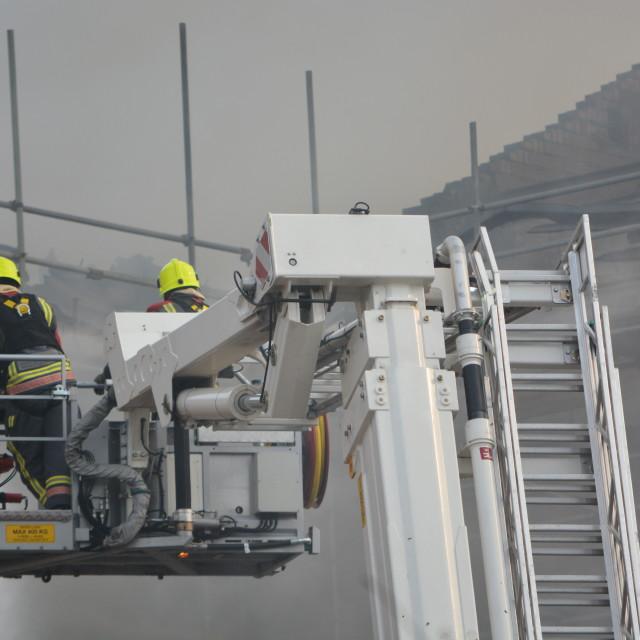 """""""firemen at work"""" stock image"""