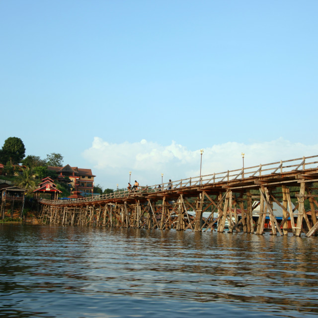"""The old wooden bridge Bridge collapse Bridge across the river and Wood bridge (Mon bridge)at sangklaburi,"" stock image"