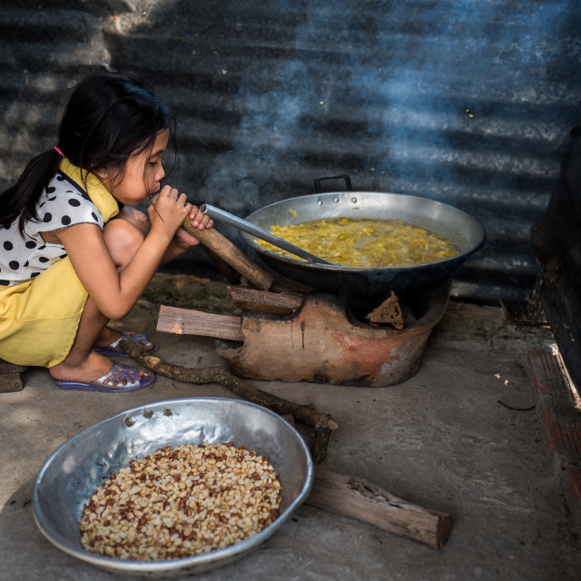 """""""The little girl making pineapple candy"""" stock image"""