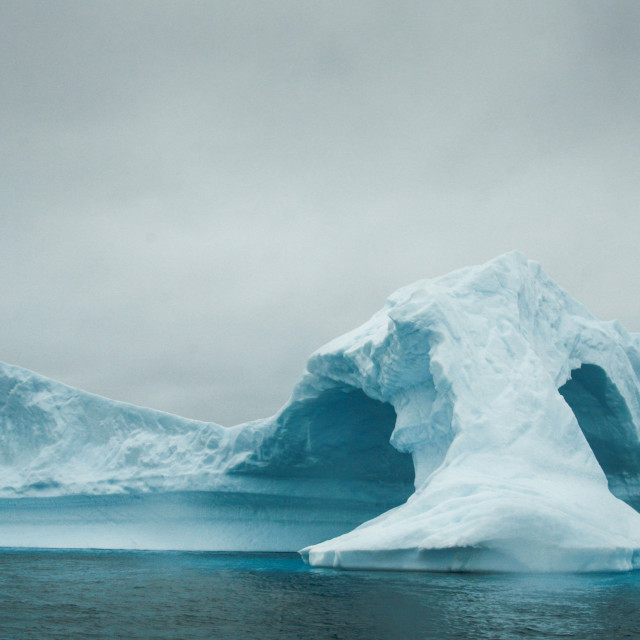 """Arched iceberg"" stock image"
