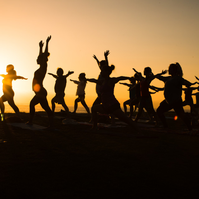 """Silhouette of yoga class"" stock image"