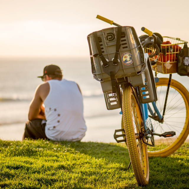 """Guy and his bike"" stock image"