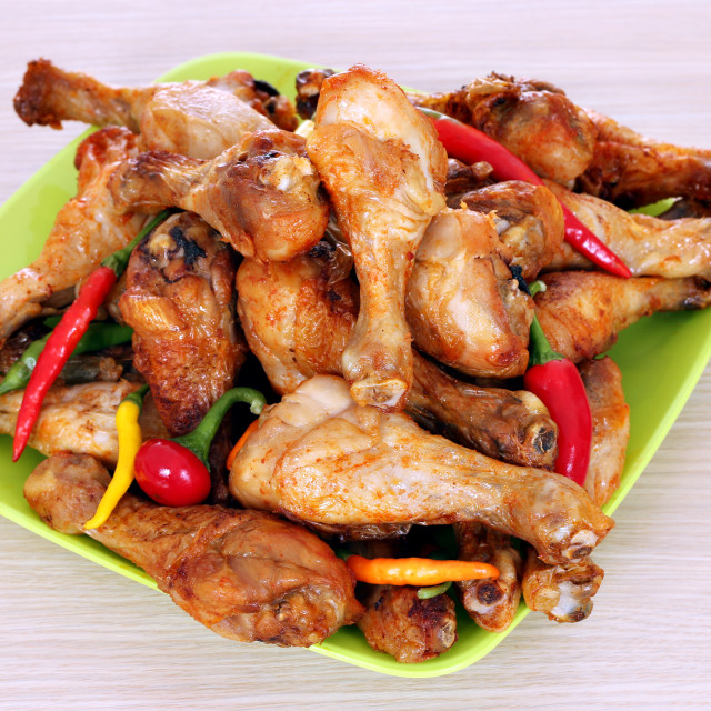 """baked chicken drumsticks on plate"" stock image"