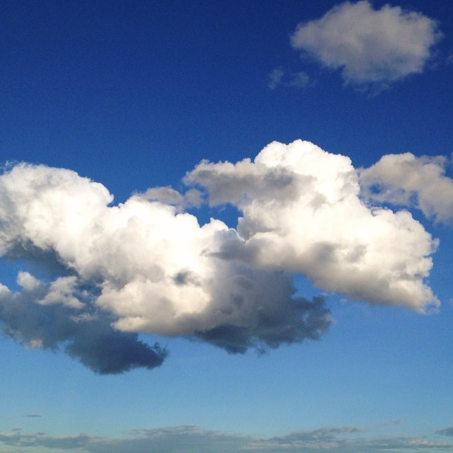 """""""Storm Clouds in a Sunny Blue Sky"""" stock image"""
