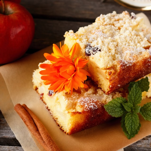 """""""Apple cake with raisins on brown paper"""" stock image"""