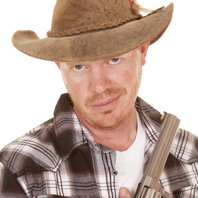 """cowboy close with gun smirk on face"" stock image"