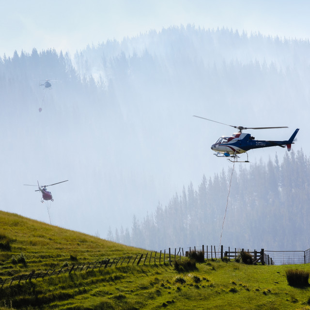 """helicopters fight forest fire"" stock image"