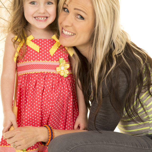 """mother daughter both looking and smiling"" stock image"
