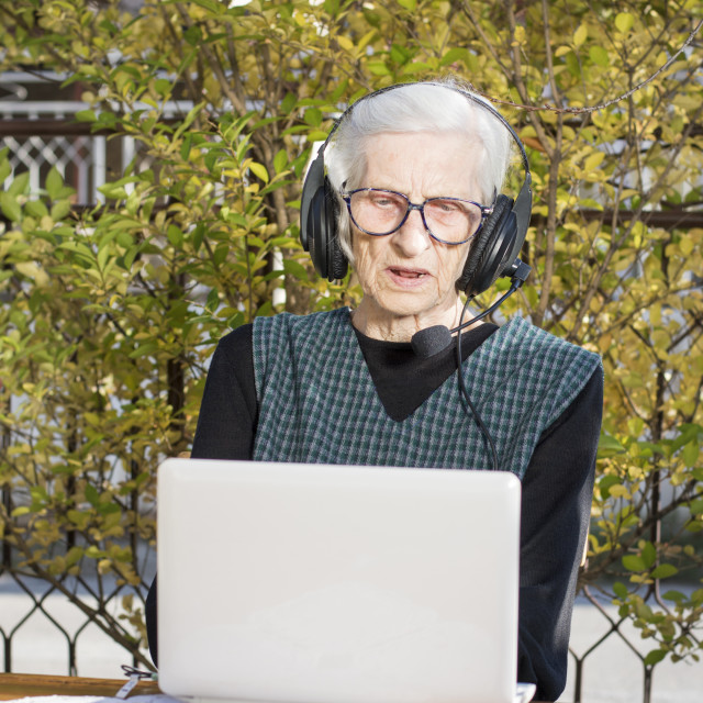 """Senior woman having a video call"" stock image"