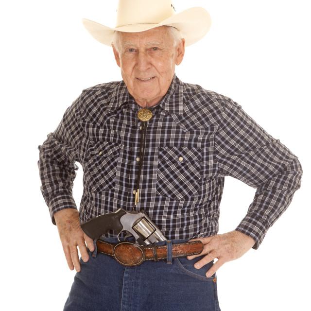 """Elderly man cowboy pistol in pants"" stock image"