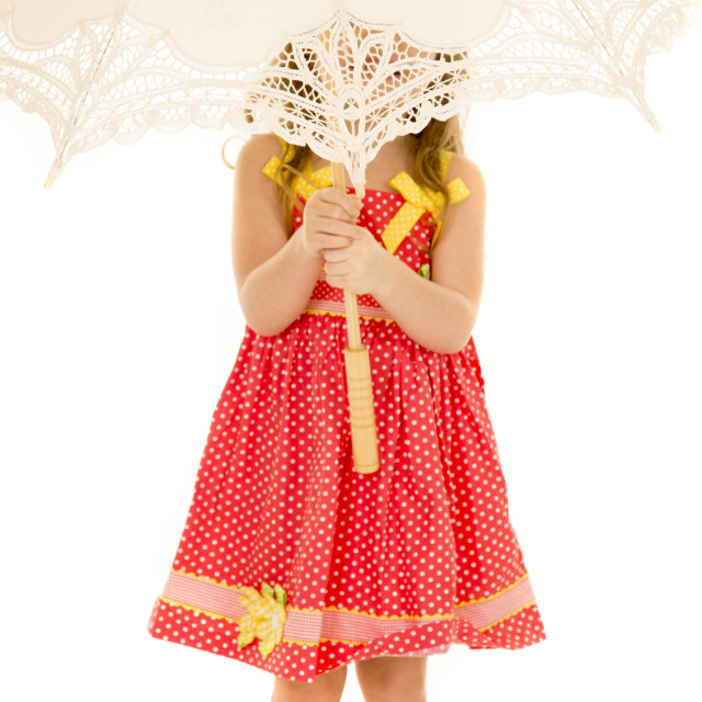 """young girl in red dress with umbrella over her face"" stock image"