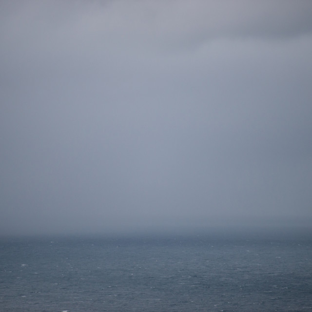 """""""Ocean background with rain clouds"""" stock image"""